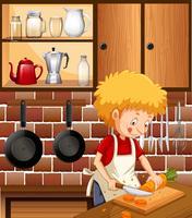 Um homem cozinhando na cozinha