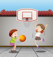 Two boys playing basketball at home