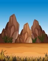 Escena del desierto con montañas y campo