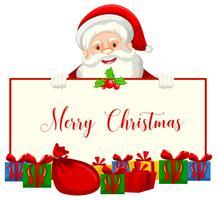 Un père Noël tenant une bannière de Noël