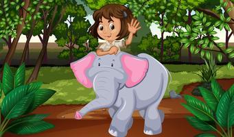 Girl riding elephant through jungle
