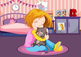 Ung tjej kramar en kattunge