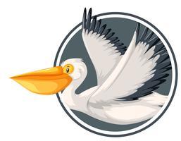 Pelikan, der in Kreisschablone fliegt