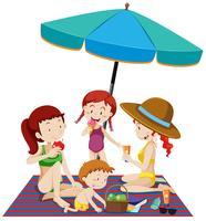 Uma família na praia férias