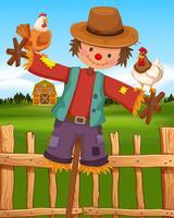 Espantapájaros y gallinas en la granja.