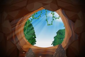 Solljus från utsidan grotta