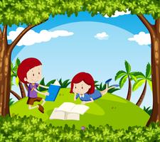 Boy and girl reading book in park