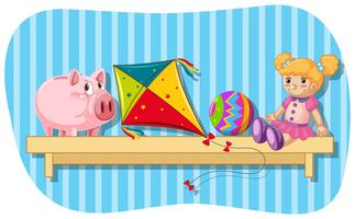 Piggybank and other toys on wooden shelf