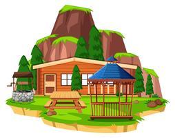 Scène met houten huis en veld