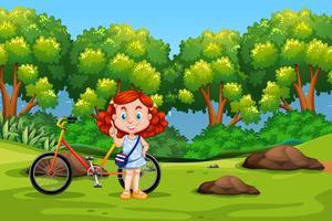 En thailändsk tjej cyklar i parken