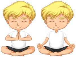 Young blond boy meditating