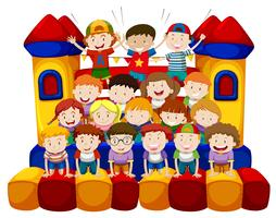 Many kids sitting on bounching house