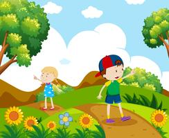 Boy and girl hiking on the hill