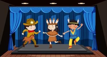 Barn som utför på scenen