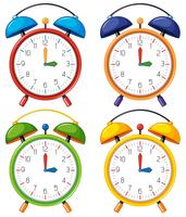 Four alarm clocks with different time