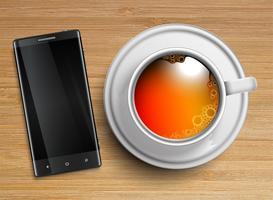 Een kopje thee met een mobiele telefoon