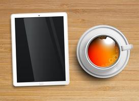 A cup of tea with a tablet