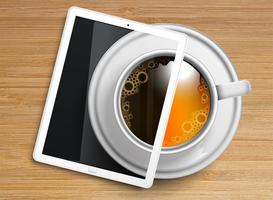 Uma xícara de café / chá com um tablet
