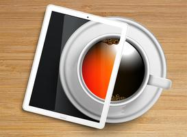 A cup of coffee/tea with a tablet