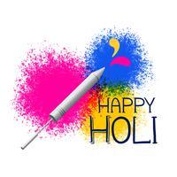 colori splatter con pichkari per il saluto del festival di holi