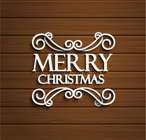 Merry Christmas on wooden background.