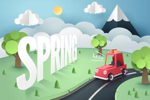 Paper art of red car country road and mountain with Hello Spring  hand lettering