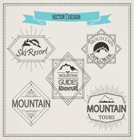 mountain and emblems