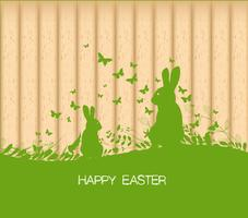 Easter greeting card with rabbit, gift and lights on the wooden background