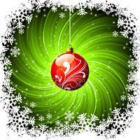 Kerstmisillustratie met glanzende rode glasbal op grunge groene achtergrond.
