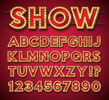 Glühlampe-Alphabet auf rotem Hintergrund