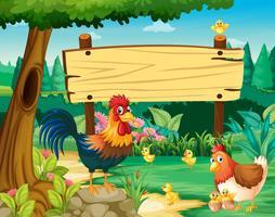 Panneau en bois et poulets dans le parc