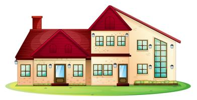 Maison au toit rouge avec pelouse verte