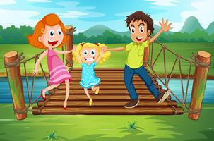 Family on the wooden bridge in the park