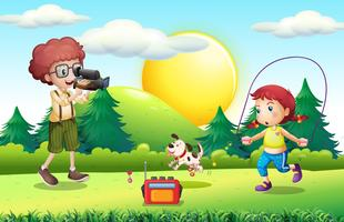 Boy shooting little girl doing jump rope