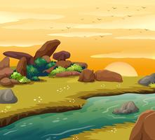 Scène de fond avec la rivière au coucher du soleil