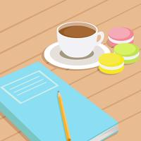 Coffee & three different colored macaroons on table