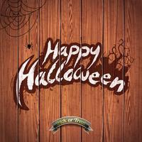 Vector el ejemplo del feliz Halloween con los elementos y la araña tipográficos en el fondo de madera.