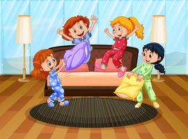 Cuatro chicas en pijama jugando con almohadas.