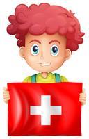 Happy boy and flag of Switzerland