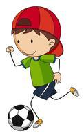 Kleine jongen voetballen