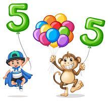 Niño y mono con globo numero cinco