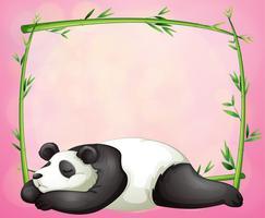 En grön ram med en panda som sover