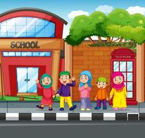 Muslim student in front of school vector