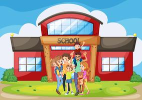 Family standing in front of school building