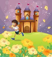 Een jongen die voor het kasteel speelt