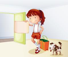 En tjej som håller ett tomt papper med en påse och en hund