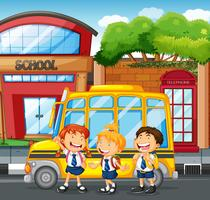 Students and school bus at the school