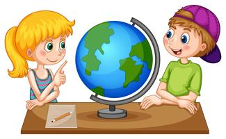 Children looking at globe on the table