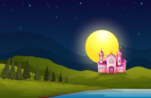 Een roze kasteel in de heuvel