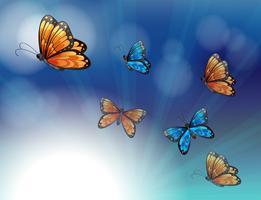 Mariposas coloridas en un papel de color degradado